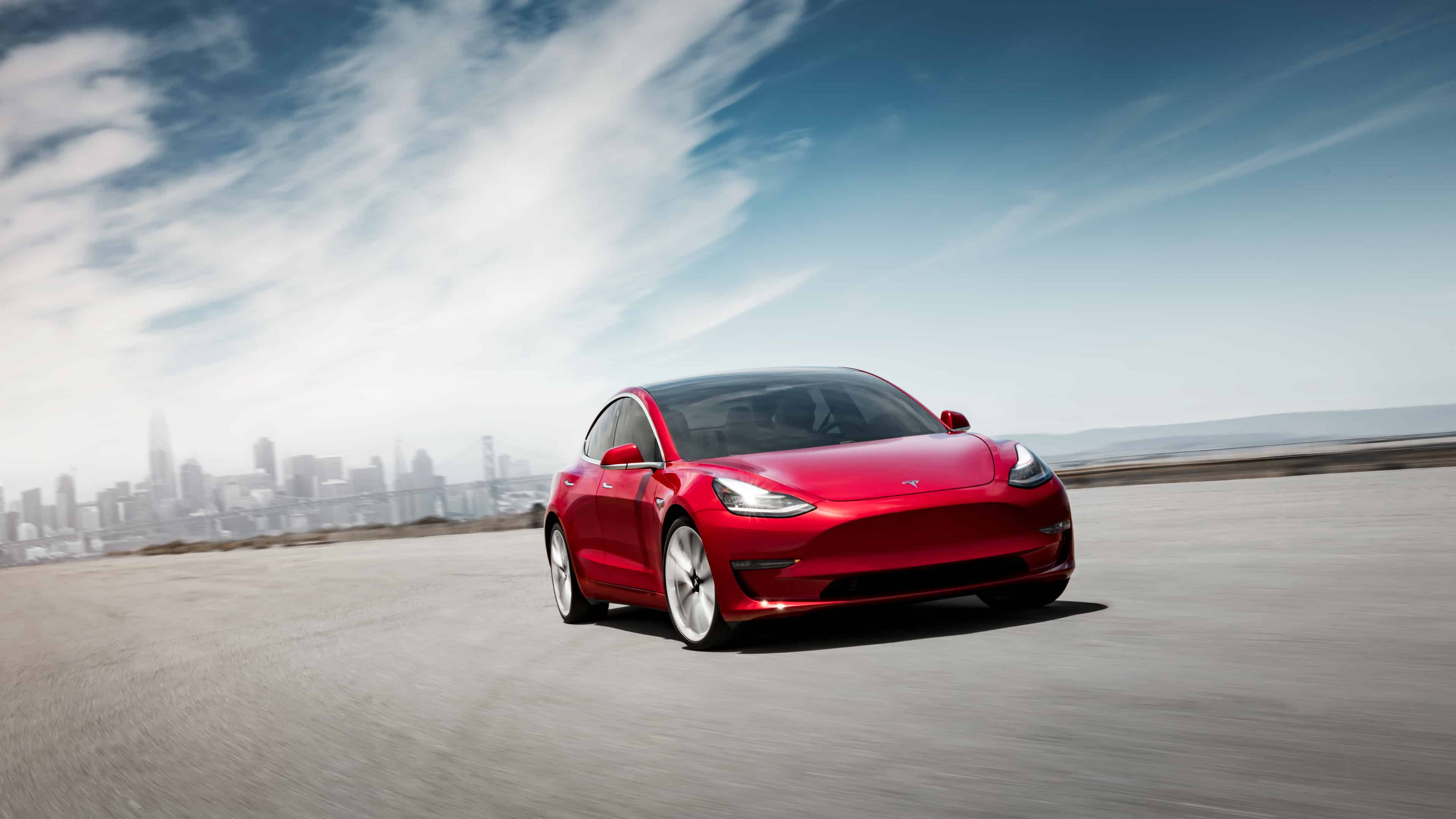 Model 3 Performance - Red Front Motion - SF Skyline